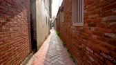 but : Fast forward view of the ancient narrow street in Lukang. It is clean but small and surrounded by old ageing buildings. Wideo