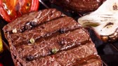 diet : Beef steak fry on the grill for barbecuing vegetables. Barbecue concept with a delicious piece of meat.