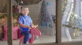 kamin : boy to play New Year Decoration Stock Footage
