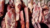 butchered : carcasses of beef hanging on hooks. Stock Footage