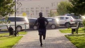 запустить : Black man running and listening to music in urban background. Handsome male doing workout outdoors.