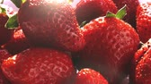 natural yogurt : Pouring yogurt onto strawberries in super slow motion