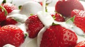 milk pouring : Pouring yogurt onto strawberries in super slow motion