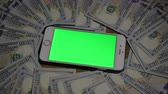 business : Smartphone where green background. 100 dollars . clous-up 4k