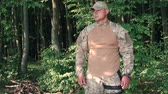 valente : Portrait of young military in the forest Stock Footage