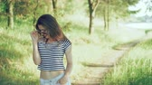 bordo : Fashion girl flirting, posing and looking on a camera in the park. 4k Stok Video