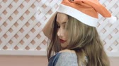 blow : Happy girl in santa hat posing on background. Slowly Stock Footage