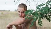 kickboxer : Close-up of free fighter practising kicks on nature at tree branches. Slowly