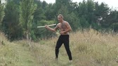 Free fighter training with pungent peg in field. Slowly