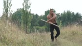 kickboxer : Free fighter training with pungent peg in field. Slowly