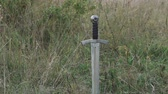 View of sword in the soil on the steppe. Slowly