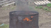 galon : The fire burns in an old rusty barrel. Slow motion