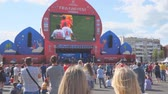 watch icon : SAMARA, RUSSIA - JUNE 21, 2018: Football fans watch the live broadcast of the match in the fan zone of the 2018 FIFA world Cup in Samara Stock Footage