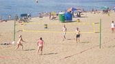 залп : SAMARA, RUSSIA - JUNE 19, 2018: A group of people, men and women playing Beach volleyball