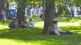 repousante : Russia, Samara, May 27, 2018: A group of young people sitting on the lawn in the Park