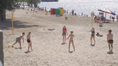 залп : SAMARA, RUSSIA - JUNE 21, 2018: A group of young people playing beach volleyball on the sand. Slow motion Стоковые видеозаписи