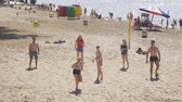 залп : SAMARA, RUSSIA - JUNE 21, 2018: A group of young people playing beach volleyball on the sand