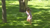 привязчивый : Russia, Samara, May 27, 2018: Girl running through the meadow in the Park