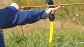 archery : Training in archery. Boy learn archery Stock Footage