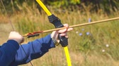 atirador : Samara, Russia - September 11, 2018: Training in archery. Boy learn archery