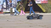 asfalt : Samara, Russia - September 11, 2018: A black radio-controlled model of a car drives fast in the park