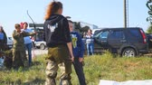 splitting : Samara, Russia - September 11, 2018: Training knife throwing. The boy learns to throw a knife