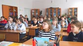 notas : CHAPAEVSK, SAMARA REGION, RUSSIA - OCTOBER 24, 2018: School kids in the classroom sitting at their desks and listen to the teacher