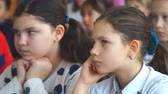 schoolchildren : CHAPAEVSK, SAMARA REGION, RUSSIA - OCTOBER 24, 2018: Two girls in the classroom at the Desk listening to the teacher. Camera panning Stock Footage