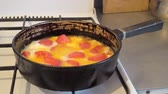 fritos : Fried eggs with tomatoes in a pan on a gas stove