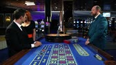 opportunities : Young coople flirting and playing roulette in casino Stock Footage