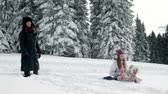 winter : family with children while enjoying in the idyllic soroundings Stock Footage
