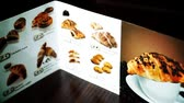 kruvasan : Menu of croissants in restaurant in slovenia Stok Video