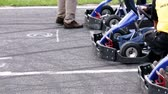 go cart : Competitors at the starting line eagerly waiting to push the gas pedals Stock Footage