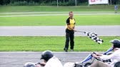 gokart : VRANSKO, SLOVENIA - SEP 2013: Referee signaling a start of a new go-kart round. Go-cart and cars simulations event. Stock Footage