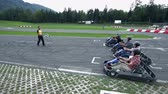 asphalt : VRANSKO, SLOVENIA - SEP 2013: Go-kart drivers are just about to start a race. Go-cart and cars simulations event.