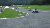 gokart : VRANSKO, SLOVENIA - SEP 2013: Go-cart racers drive through edgy turn. Go-cart and cars simulations event. Stock Footage