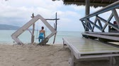 indonesia : Woman on a swing in Gili Air island, Indonesia