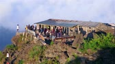 indonesia : People walking and gathering on top of mount Batur volcano, Bali. People walking and gathering on top of mount Batur volcano, Bali
