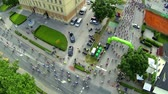 j��zda na kole : VRHNIKA, SLOVENIA - AUGUST 2014: Flying above big group of cyclist riding on main city road. Wide shot of professional bicyclists driving on main road through start line.