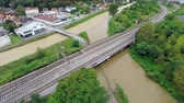 flooded road : Flying over river and railway with flooded road under. Aerial footage of flooding rivers join in to one river while  flood reaches lower parts.