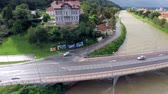 flooded road : Aerial view of bridge and river flowing under. Aerial footage of rising river almost reaching top of bridge road.