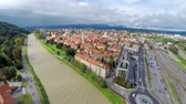flooded road : High river level with cityscape aerial view. Flying above river with view over Celje city, while river almost flooding over the edge.