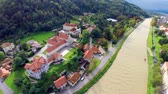 flooded road : Aerial of river almost flooding around. River Savinja in Celje city almost flooding after massive rainstorm. Stock Footage