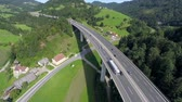 paisagem : Big highway road bridge in a nature. Aerial shoot of a nice construction highway bridge in a nature and motorway road under the bridge Stock Footage