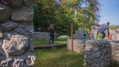 knight : SENTJUR, SLOVENIA - OCTOBER 2014: Free running on the ruins in the woods. Slow motion footage of a man free running amounts the castle ruins in the middle of beautiful landscape on the sunny summer day. Stock Footage