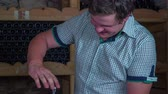 connoisseur : Waiter inserts the bottle opener in to the cork. Slow motion close up RAW footage of a waiter in the wine caller opening the battle with cork in the domestic restoration.