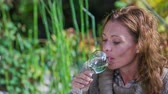 week end : Woman drinking the glass of wine . Close up RAW footage of a woman testing the wine from the glass in the middle of a country side on the romantic dinner. Stock Footage