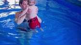 game : On this video you can see a baby, his mother and game in a pool in  which is the baby for the first time.