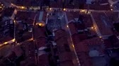 mroczne : In this video, we can see a raised-relief map of the city centre on a summer night. Close-up shot. There are lights seen on the buildings.