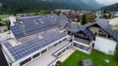 solar energy power : This is air view on school with solar panels on roof which is on a beautiful location in the middle of nature which is placed in a beautiful environment on countryside.